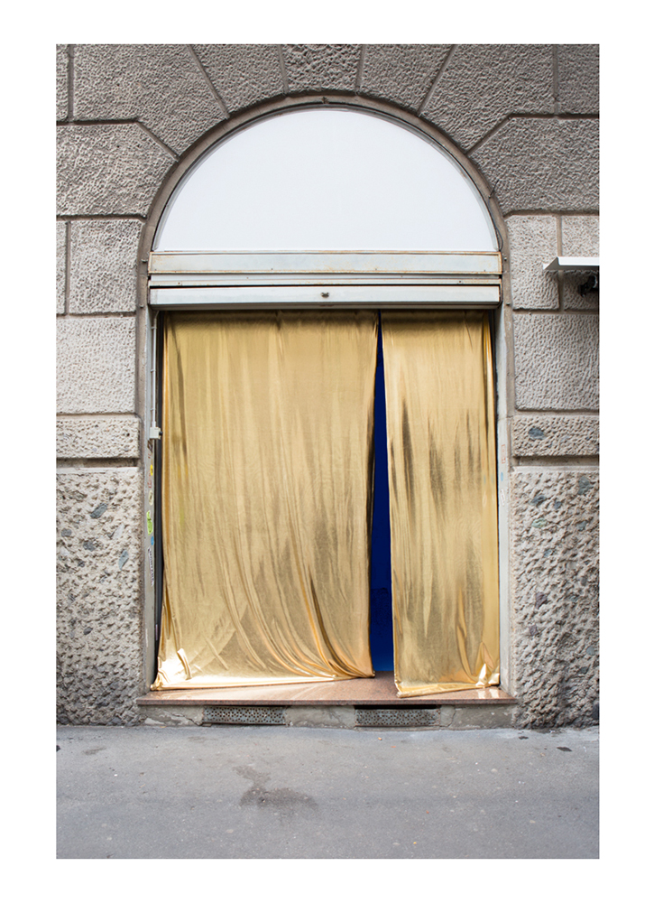 A Doorway To Multiplicity installed at Nowhere Gallery Milan (Golden lycra fabric, blue light 3x2.5m), 2018