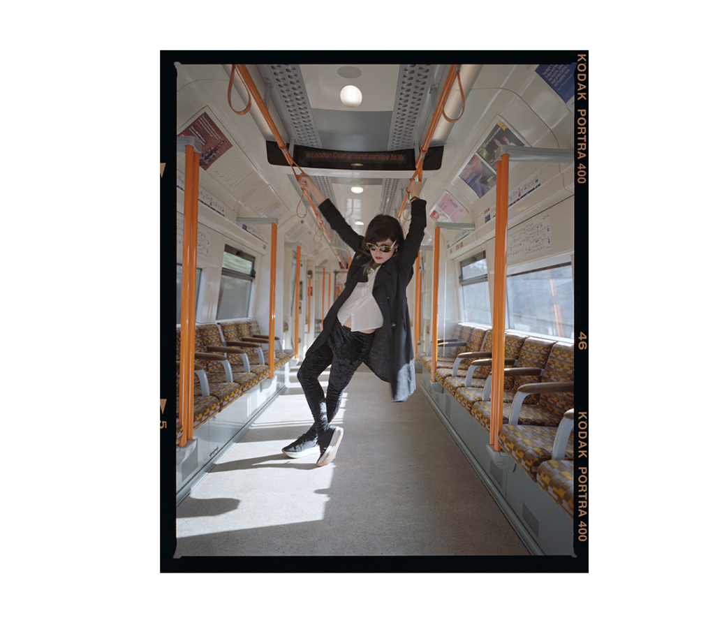 Sordid Pop Musician Krista Papista on the London Overground for Notes For A New World Order, 2017